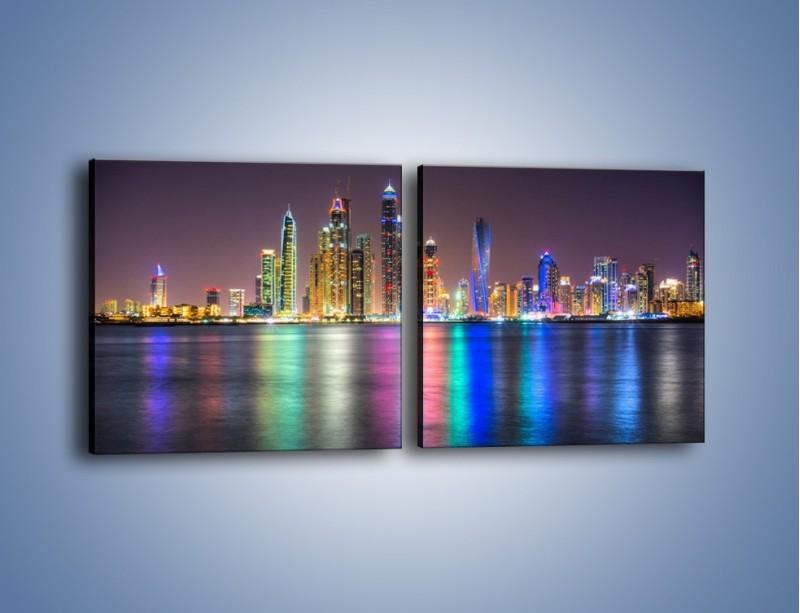 Obraz na płótnie – Kolorowe drapacze chmur w Dubaju – dwuczęściowy kwadratowy poziomy AM724