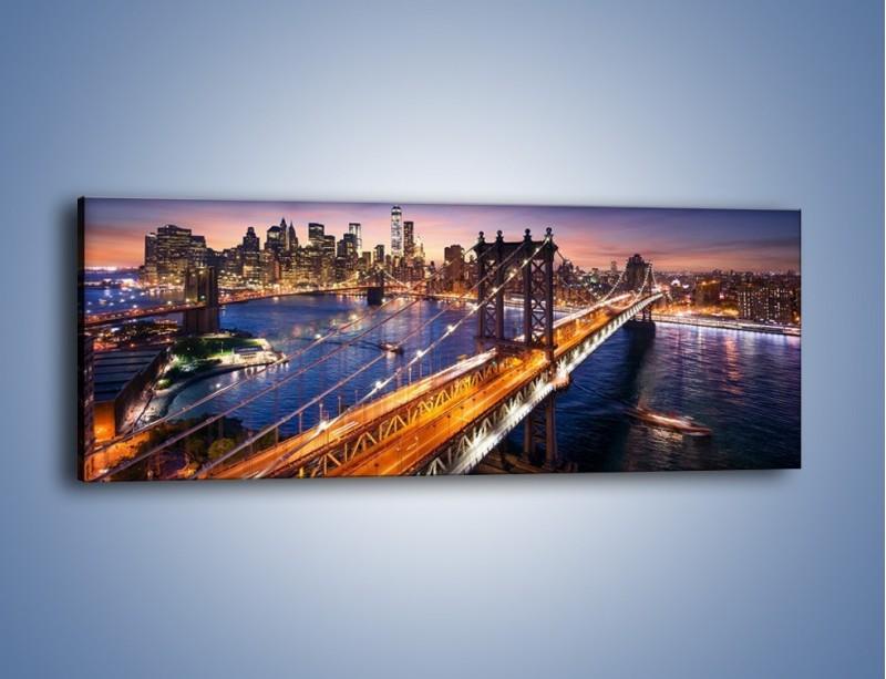 Obraz na płótnie – Zachodzące słońce nad Manhattanem – jednoczęściowy panoramiczny AM377