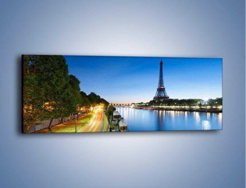 Obraz na płótnie – Zapadający zmrok w Paryżu – jednoczęściowy panoramiczny AM385