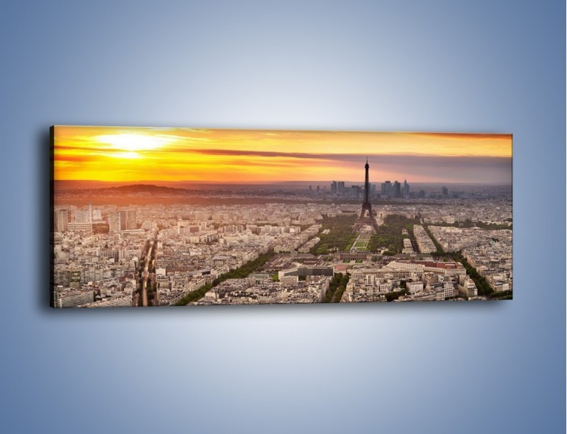 Obraz na płótnie – Zachód słońca nad Paryżem – jednoczęściowy panoramiczny AM420