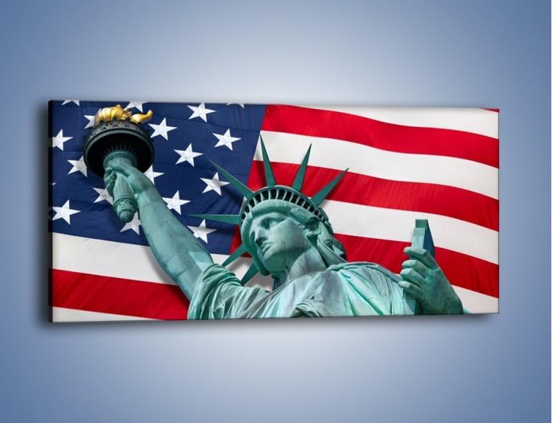 Obraz na płótnie – Statua Wolności na tle flagi USA – jednoczęściowy panoramiczny AM435