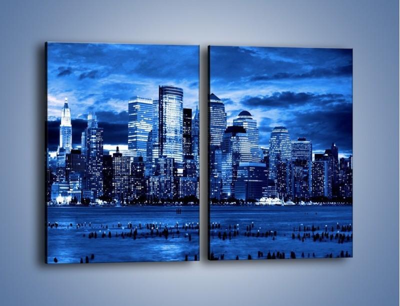 Obraz na płótnie – Wieżowce w odcieniach niebieskiego – dwuczęściowy prostokątny pionowy AM017