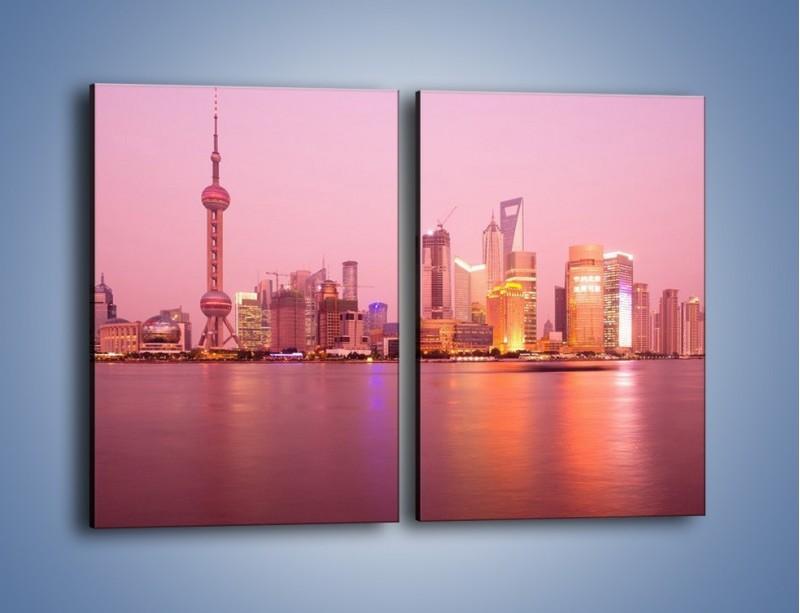 Obraz na płótnie – Miasto o poranku w odcieniach różu – dwuczęściowy prostokątny pionowy AM020