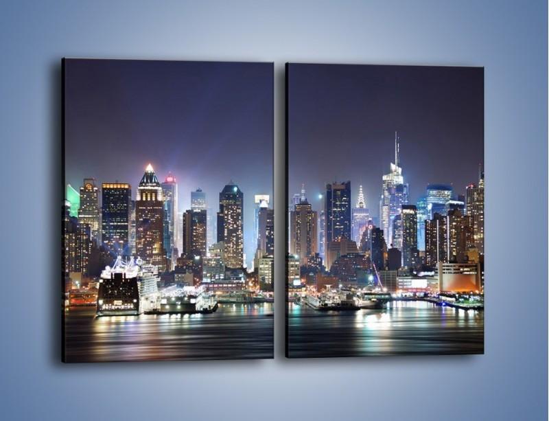 Obraz na płótnie – Oświetlone miasto nocą – dwuczęściowy prostokątny pionowy AM034
