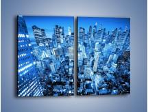 Obraz na płótnie – Centrum miasta w niebieskich kolorach – dwuczęściowy prostokątny pionowy AM042