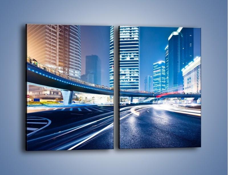 Obraz na płótnie – Wieczorny ruch uliczny w centrum miasta – dwuczęściowy prostokątny pionowy AM051