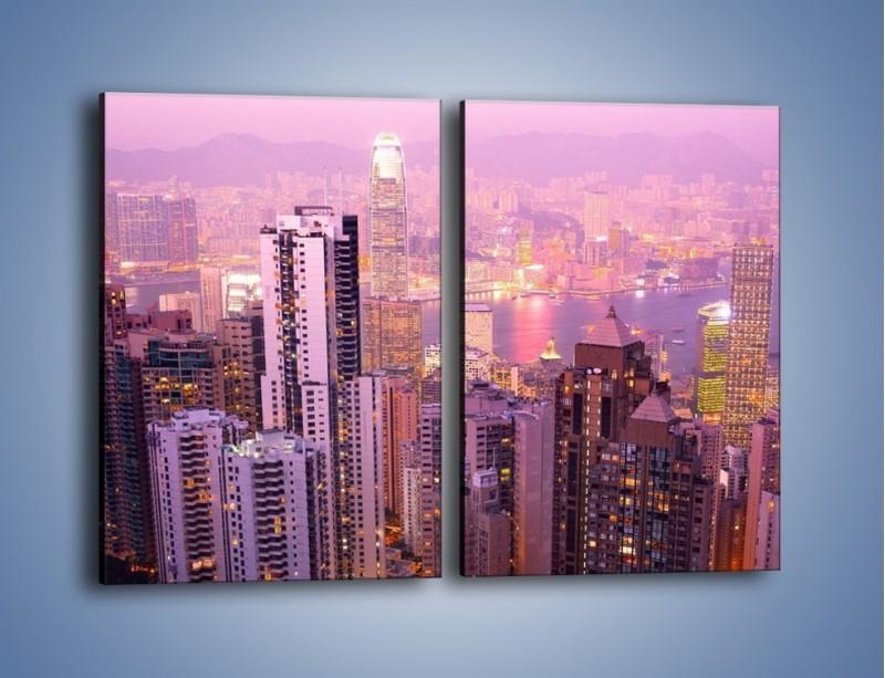Obraz na płótnie – Duże miasto budzące się o poranku do życia – dwuczęściowy prostokątny pionowy AM062