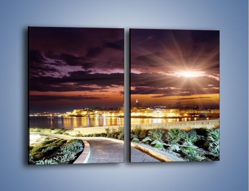Obraz na płótnie – Błysk światła nad miastem wieczorową porą – dwuczęściowy prostokątny pionowy AM063