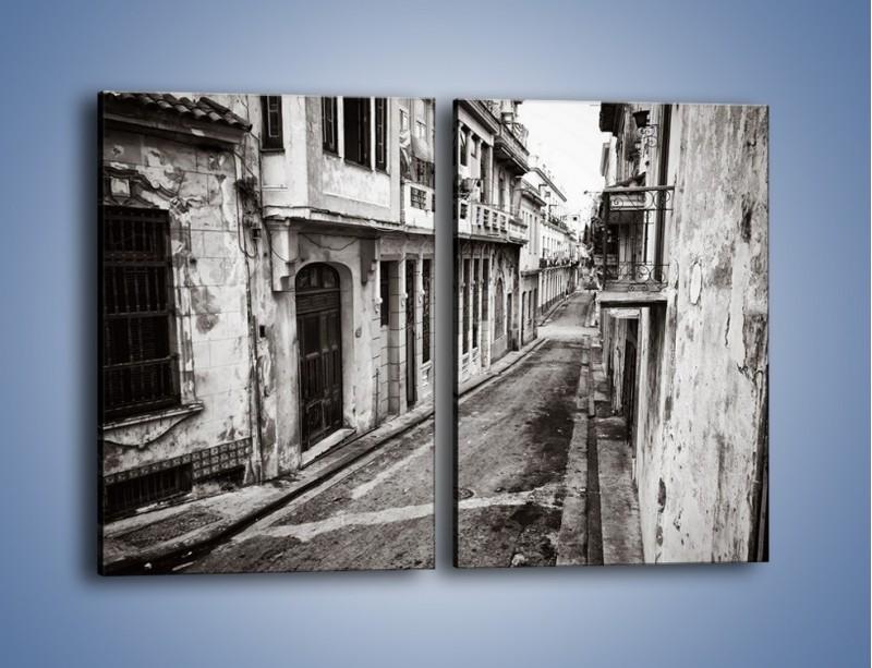 Obraz na płótnie – Urokliwa uliczka w starej części miasta – dwuczęściowy prostokątny pionowy AM124