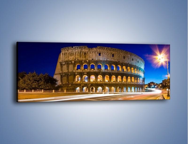 Obraz na płótnie – Koloseum po zmierzchu – jednoczęściowy panoramiczny AM443