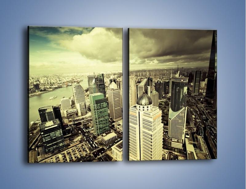Obraz na płótnie – Ciemne chmury nad miastem – dwuczęściowy prostokątny pionowy AM130