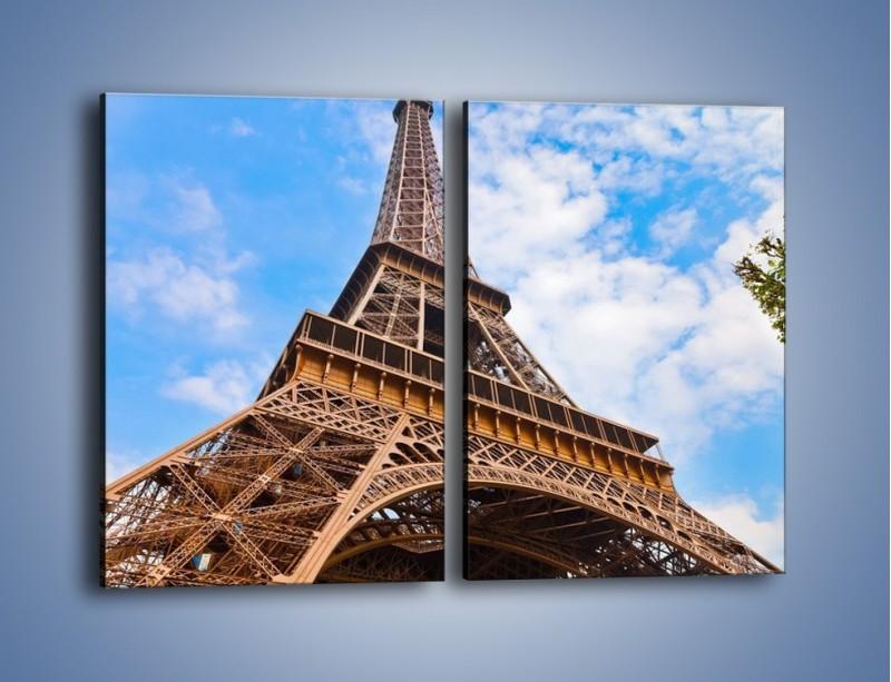 Obraz na płótnie – Wieża Eiffla pod chmurkami – dwuczęściowy prostokątny pionowy AM173