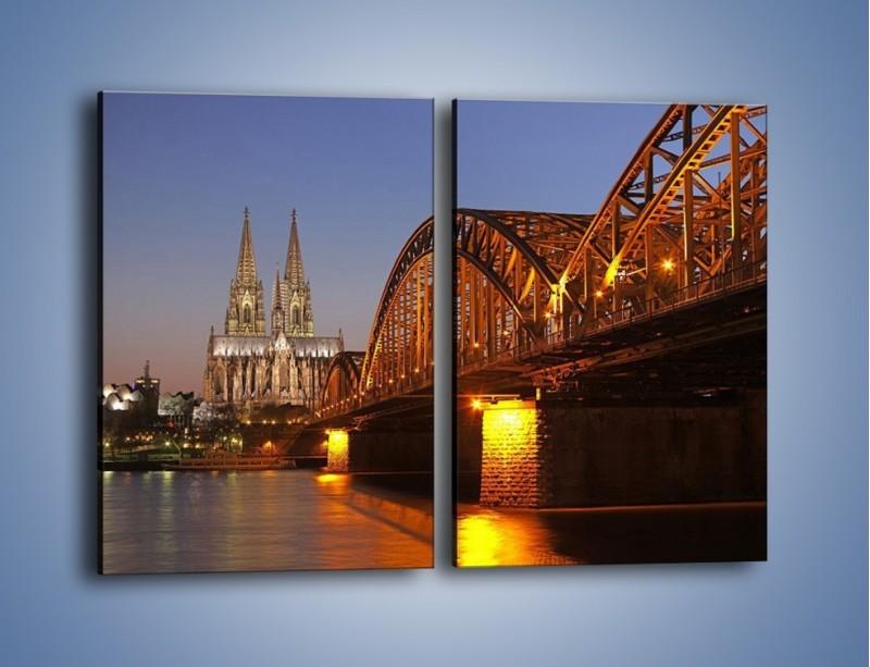 Obraz na płótnie – Most na tle kościoła – dwuczęściowy prostokątny pionowy AM186