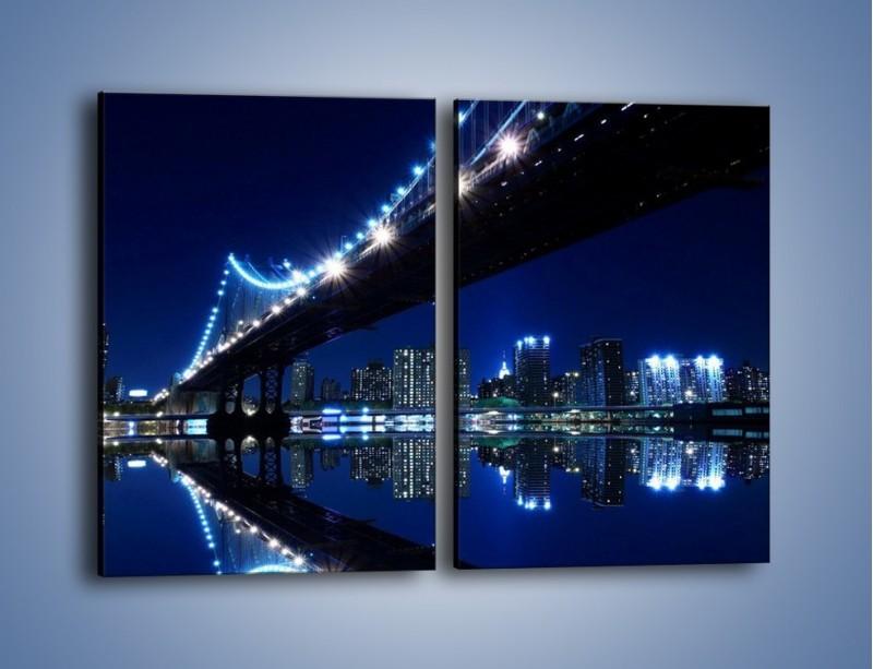 Obraz na płótnie – Oświetlony most w odbiciu wody – dwuczęściowy prostokątny pionowy AM211