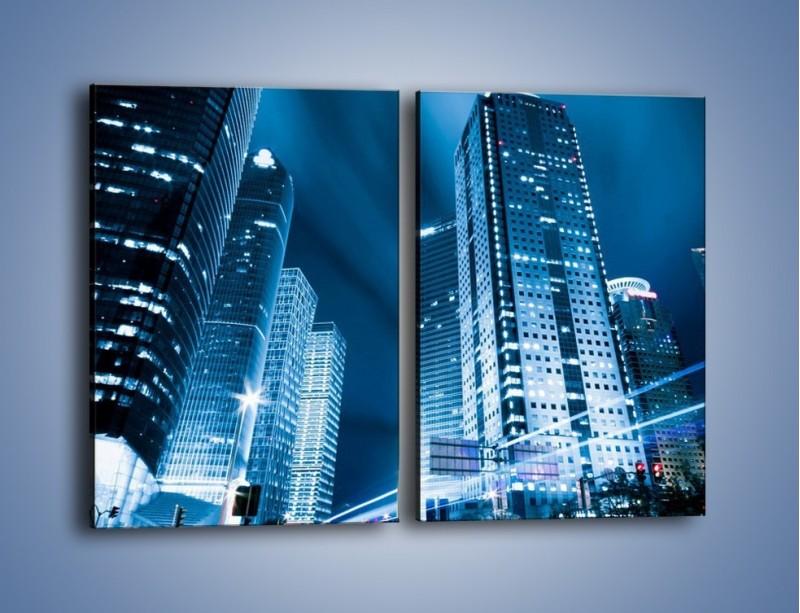 Obraz na płótnie – Wieżowce w mieście nocą – dwuczęściowy prostokątny pionowy AM216