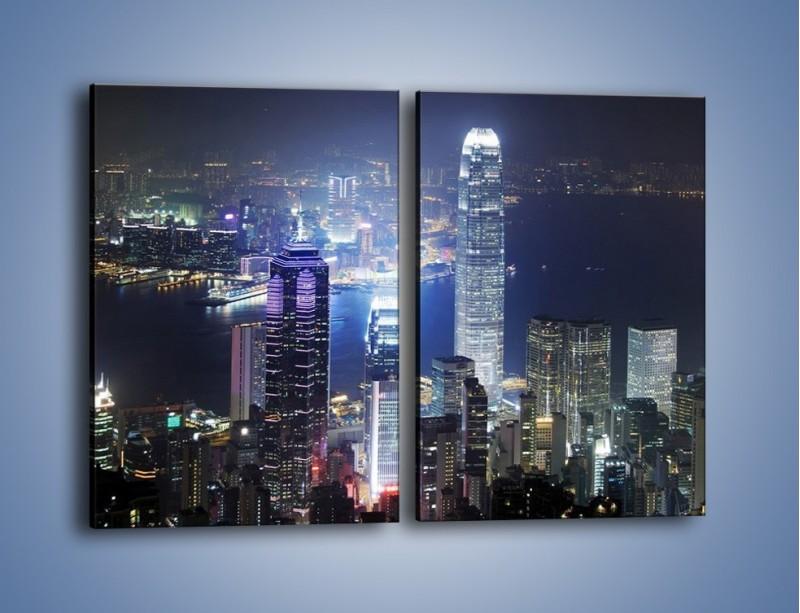 Obraz na płótnie – Miasto oświetlone nocą – dwuczęściowy prostokątny pionowy AM223