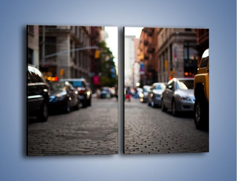 Obraz na płótnie – Rozmyty świat centrum miasta – dwuczęściowy prostokątny pionowy AM367