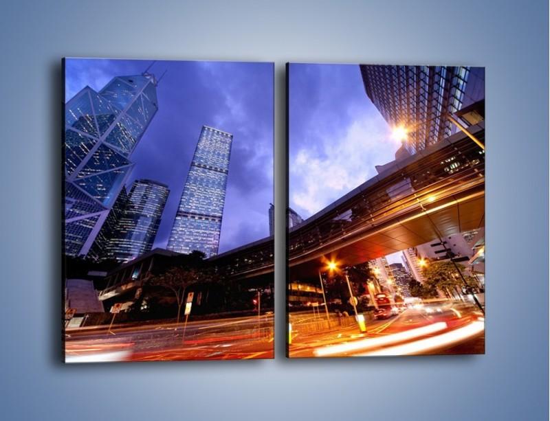 Obraz na płótnie – Drapacze chmur i wieczorny ruch uliczny – dwuczęściowy prostokątny pionowy AM487