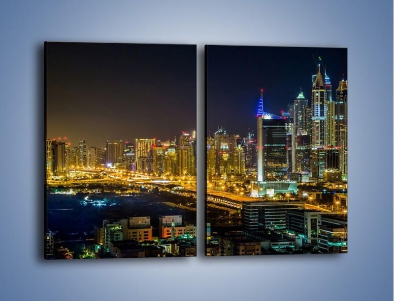 Obraz na płótnie – Oświetlony Dubaj nocą – dwuczęściowy prostokątny pionowy AM506