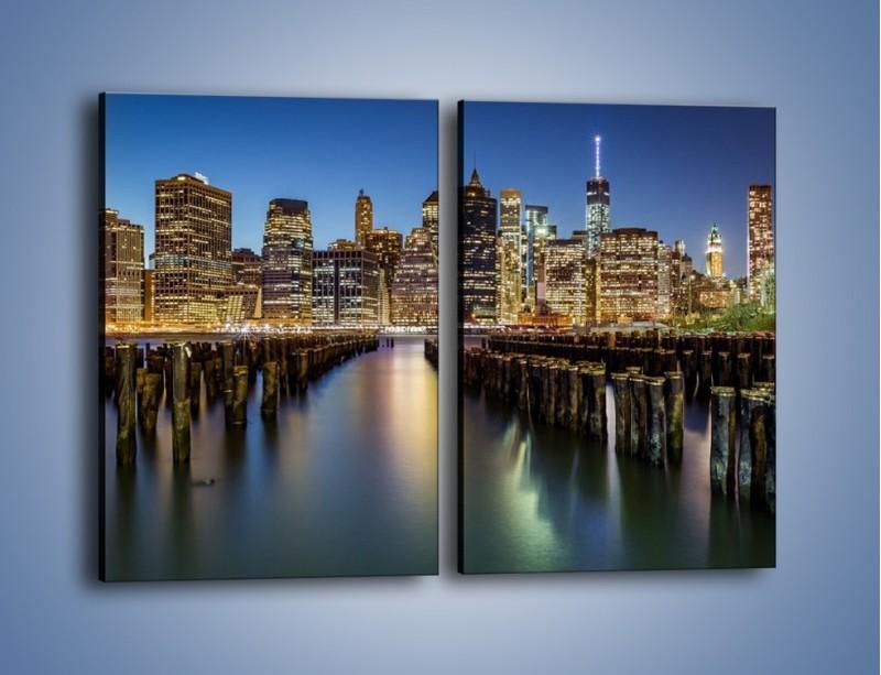 Obraz na płótnie – Zniszczone molo i widok na Manhattan – dwuczęściowy prostokątny pionowy AM601