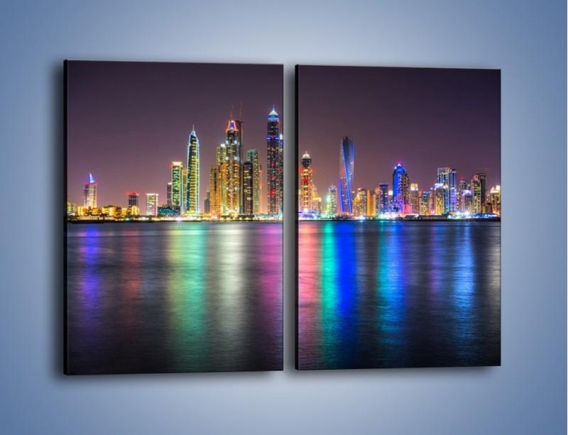 Obraz na płótnie – Kolorowe drapacze chmur w Dubaju – dwuczęściowy prostokątny pionowy AM724