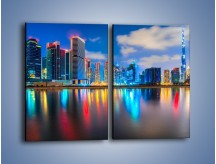 Obraz na płótnie – Kolory Dubaju odbite w wodzie – dwuczęściowy prostokątny pionowy AM740