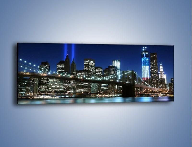 Obraz na płótnie – Most Brookliński nocą – jednoczęściowy panoramiczny AM476