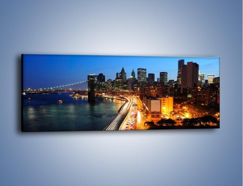 Obraz na płótnie – Manhattan wieczorową porą – jednoczęściowy panoramiczny AM477