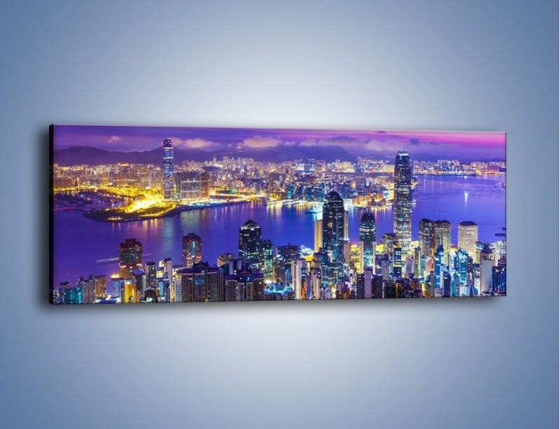Obraz na płótnie – Wieczorna panorama Hong Kongu – jednoczęściowy panoramiczny AM505