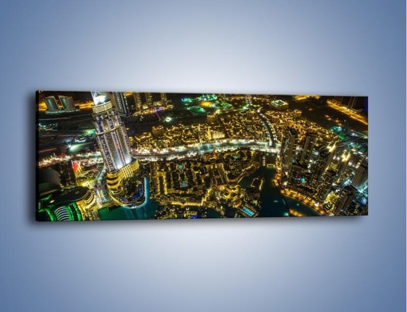 Obraz na płótnie – Dubaj nocą z lotu ptaka – jednoczęściowy panoramiczny AM507