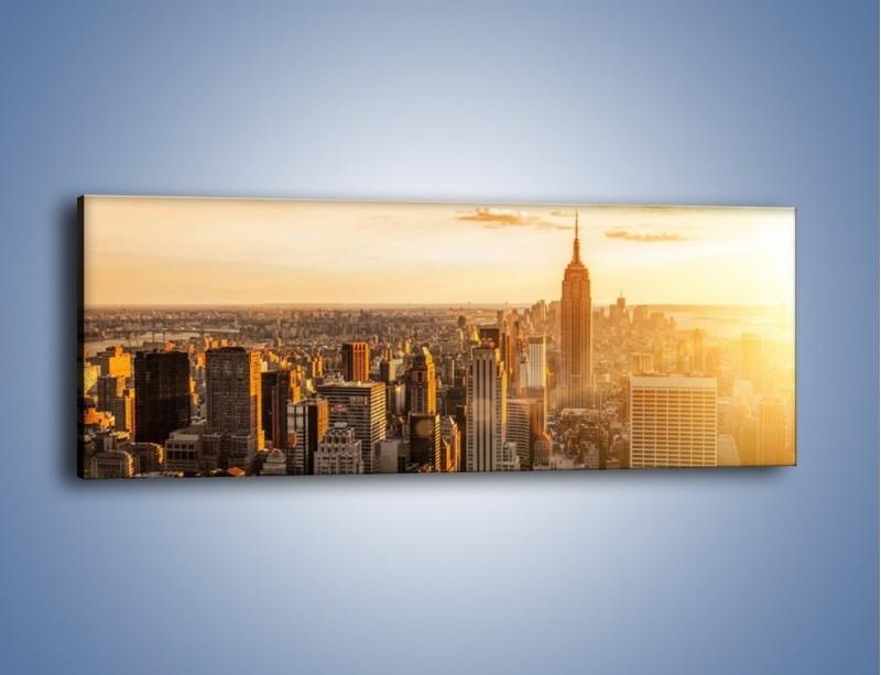 Obraz na płótnie – Zachód słońca nad Nowym Jorkiem – jednoczęściowy panoramiczny AM550