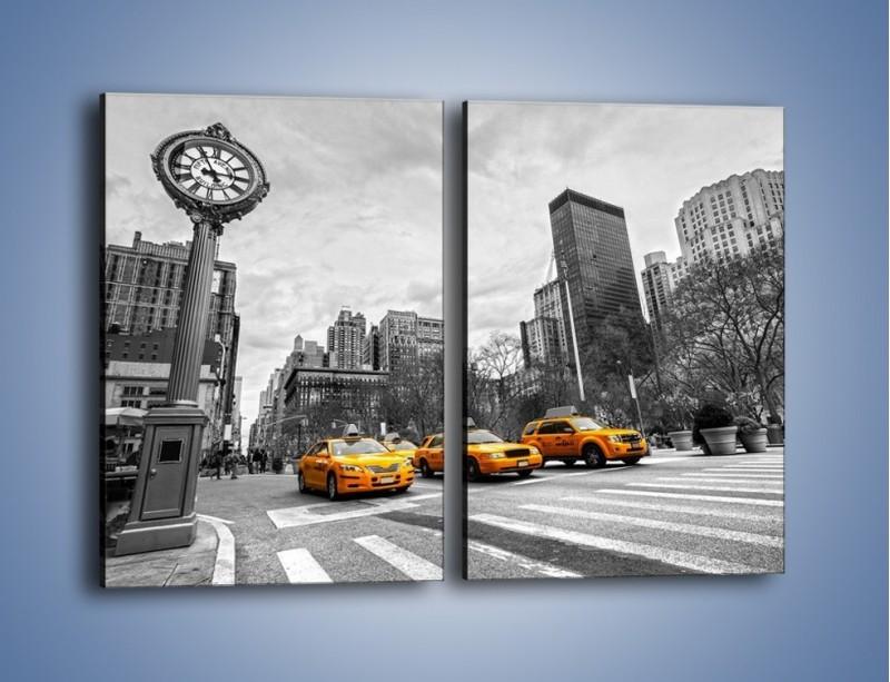 Obraz na płótnie – Żółte taksówki na szarym tle miasta – dwuczęściowy prostokątny pionowy TM225