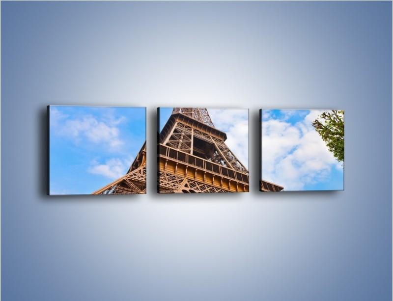 Obraz na płótnie – Wieża Eiffla pod chmurkami – trzyczęściowy AM173W1