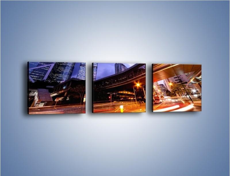 Obraz na płótnie – Drapacze chmur i wieczorny ruch uliczny – trzyczęściowy AM487W1