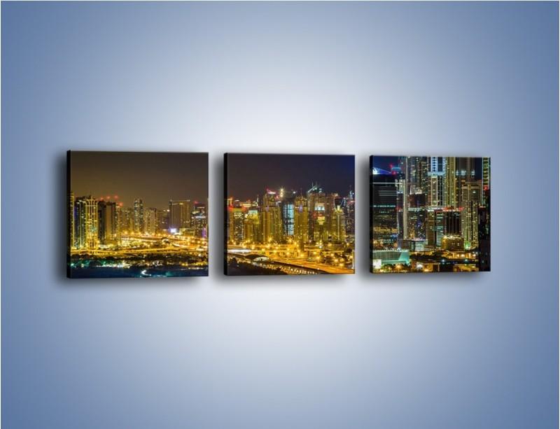 Obraz na płótnie – Oświetlony Dubaj nocą – trzyczęściowy AM506W1
