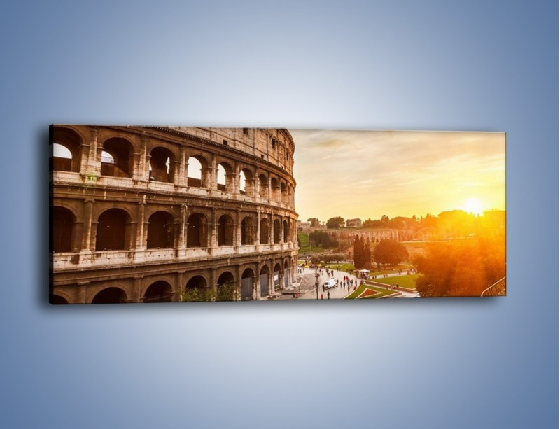 Obraz na płótnie – Rzymskie Koloseum o zachodzie słońca – jednoczęściowy panoramiczny AM684