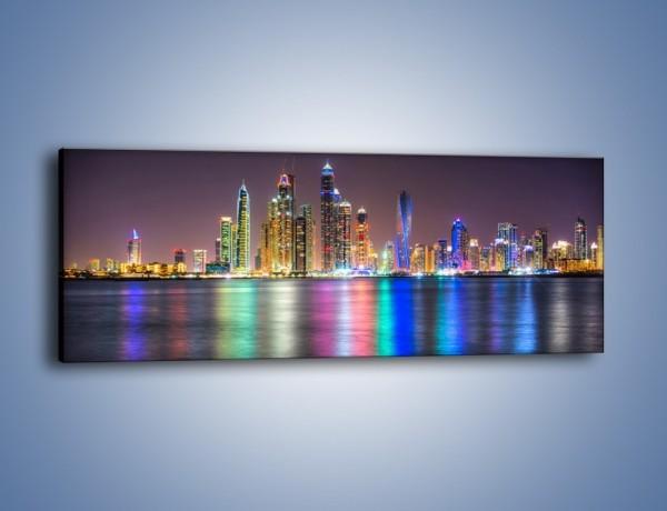 Obraz na płótnie – Kolorowe drapacze chmur w Dubaju – jednoczęściowy panoramiczny AM724