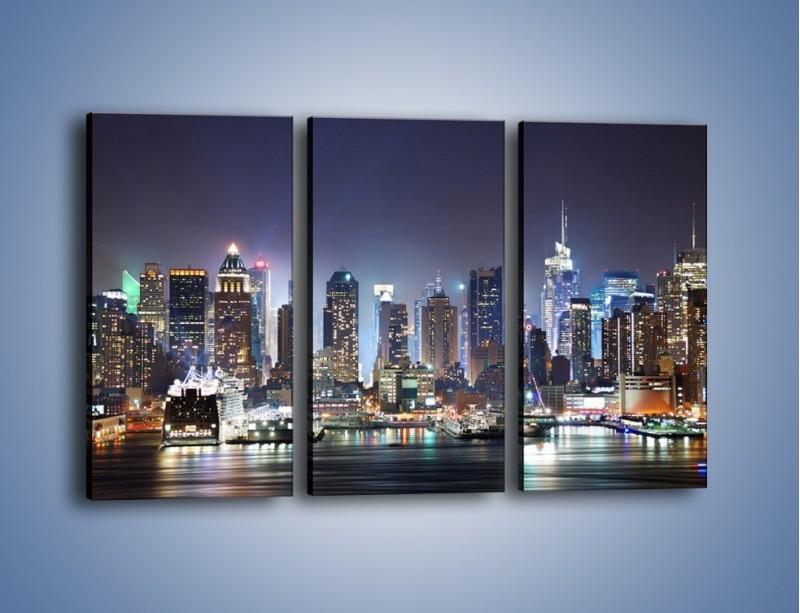 Obraz na płótnie – Oświetlone miasto nocą – trzyczęściowy AM034W2