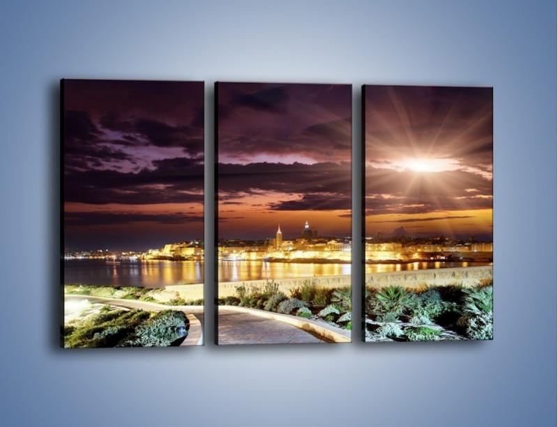 Obraz na płótnie – Błysk światła nad miastem wieczorową porą – trzyczęściowy AM063W2