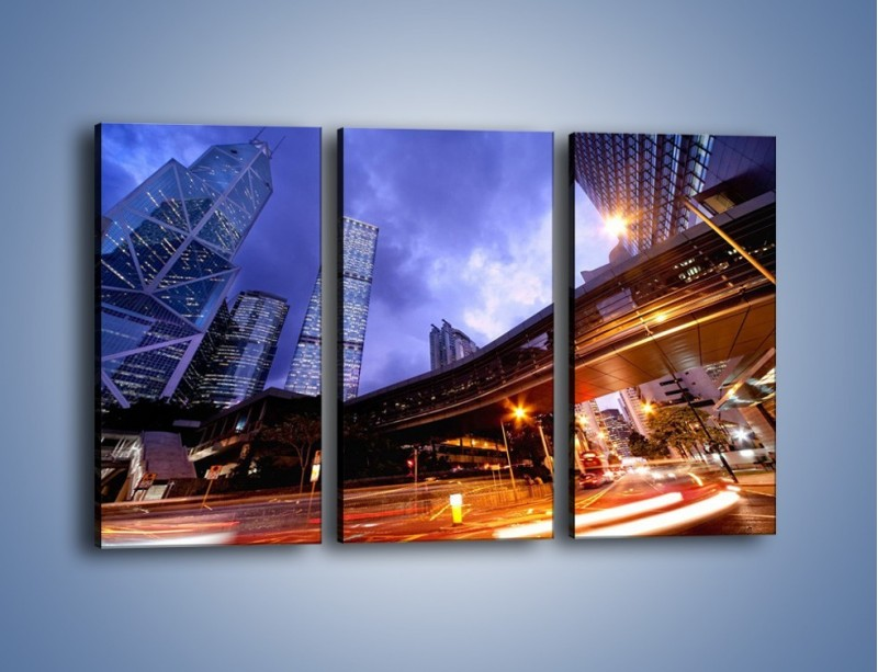 Obraz na płótnie – Drapacze chmur i wieczorny ruch uliczny – trzyczęściowy AM487W2