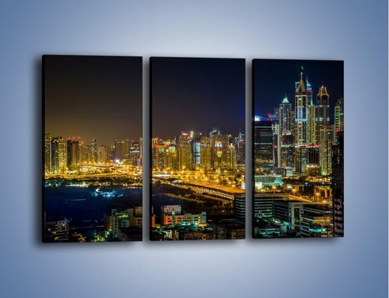 Obraz na płótnie – Oświetlony Dubaj nocą – trzyczęściowy AM506W2