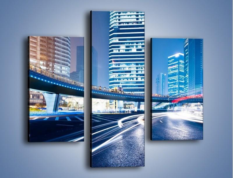 Obraz na płótnie – Wieczorny ruch uliczny w centrum miasta – trzyczęściowy AM051W3