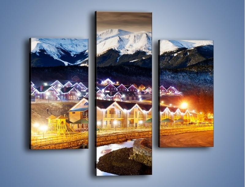 Obraz na płótnie – Oświetlone domki pod górami – trzyczęściowy AM070W3