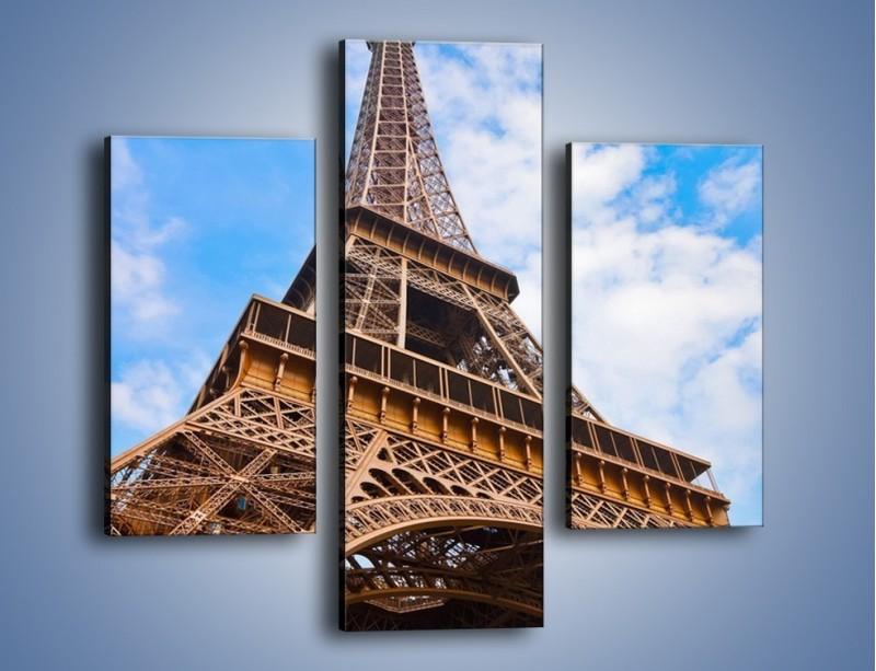 Obraz na płótnie – Wieża Eiffla pod chmurkami – trzyczęściowy AM173W3