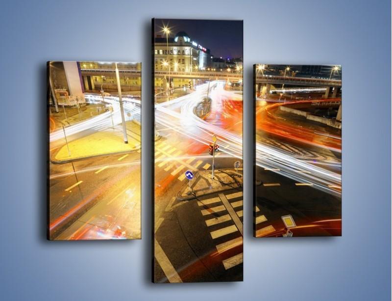 Obraz na płótnie – Światła samochodów w ruchu na skrzyżowaniu – trzyczęściowy AM279W3