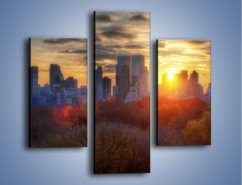 Obraz na płótnie – Wschód słońca nad miastem – trzyczęściowy AM318W3