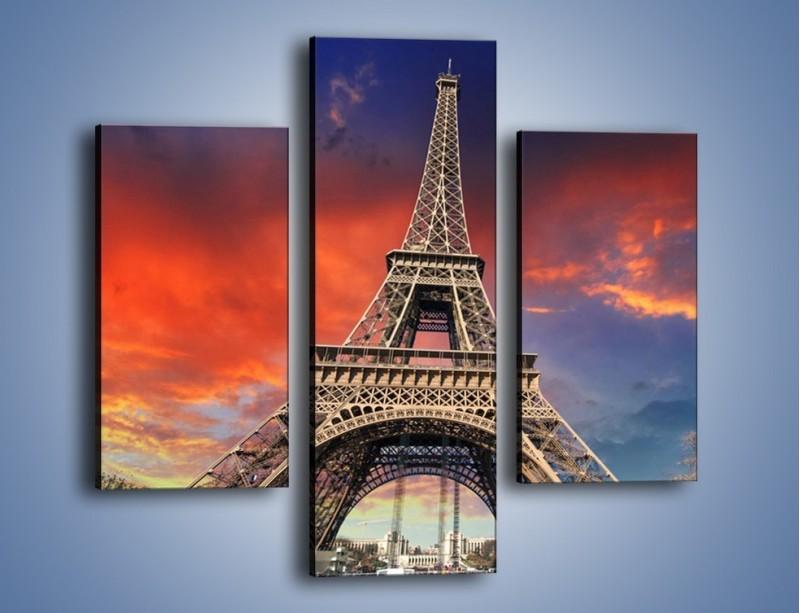 Obraz na płótnie – Wieża Eiffla pod niebiesko-czerwonym niebem – trzyczęściowy AM463W3
