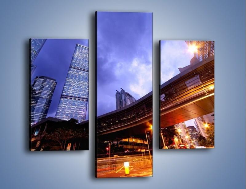 Obraz na płótnie – Drapacze chmur i wieczorny ruch uliczny – trzyczęściowy AM487W3