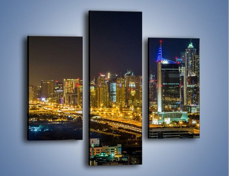 Obraz na płótnie – Oświetlony Dubaj nocą – trzyczęściowy AM506W3
