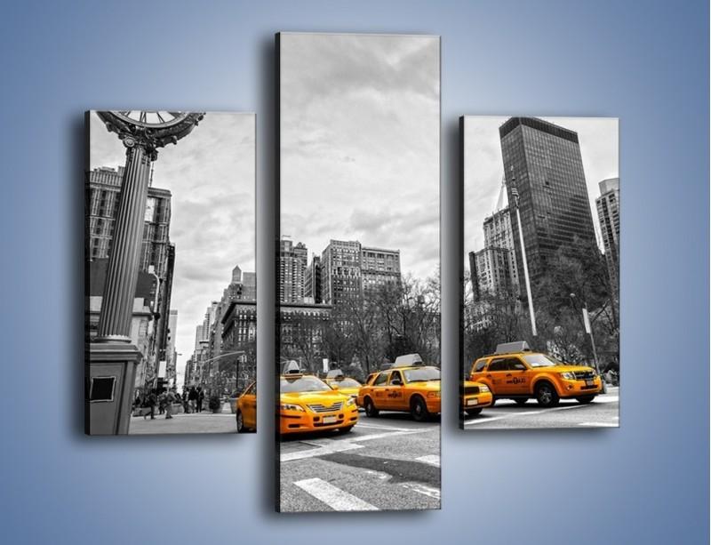 Obraz na płótnie – Żółte taksówki na szarym tle miasta – trzyczęściowy TM225W3